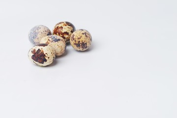 five quail eggs on a white background. preparation for Easter