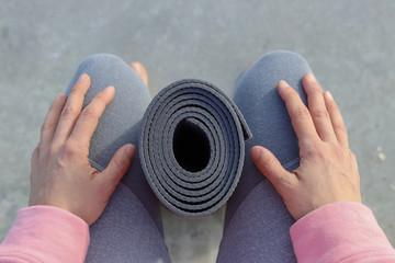 yoga mat between the legs ready to start the class