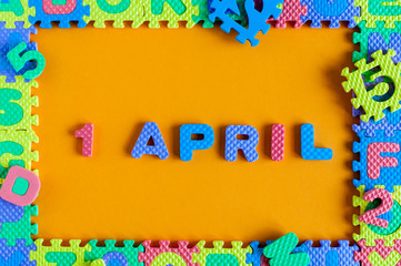 April 1st. Day 1 of april month, calendar child toy - puzzle. Spring time, Easter and fools day