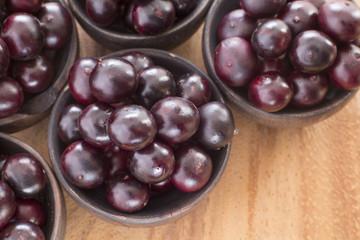Acai fruits in wooden bowls - Euterpe oleracea