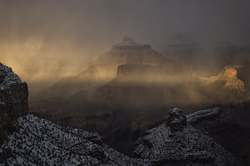 Snow showers in Grand Canyon at sunset;  Arizona