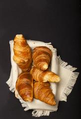 Croissants on black background