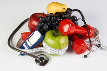Stethoscope with blood sugar control glucometer glucose meter, fruits and dumbbells for using in fitness, concept to control diabetes, Exercise in Diabetes Patients and Healthy lifestyle concept
