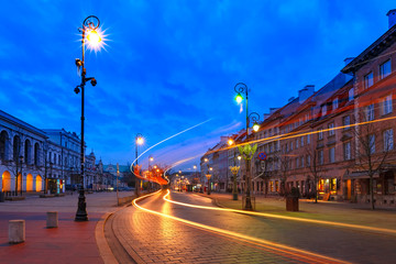 Krakowskie Przedmiescie street, part of the Royal Route in Old Town during evening blue hour, Warsaw, Poland.