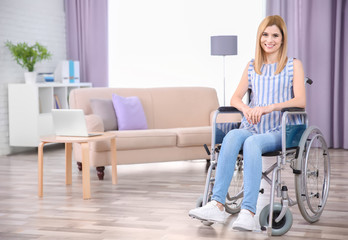 Young woman in wheelchair indoors