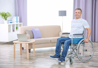 Mature man in wheelchair indoors