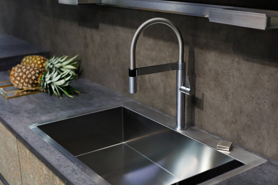 sink with a tap on a kitchen counter