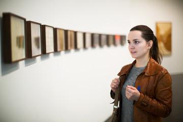 Brunette woman in art museum