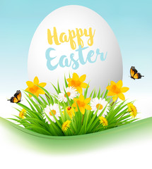 Easter Holiday Background. Colofrul eggs in green grass and flowers. Vector..