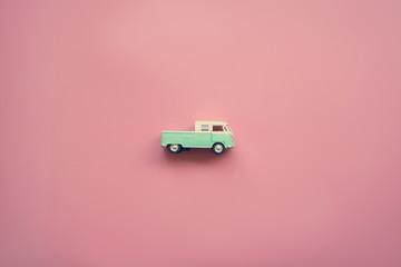 Vintage van truck on pink pastel background.