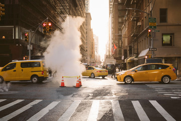 Manhattan morning sunrise view with yellow cabs