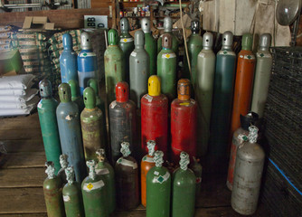 Steel bottles of compressed gasses in warehouse, 2107.