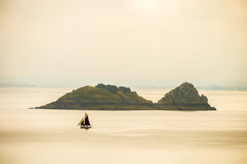 Scenic view of a boat ship crossing sailing the coast of Normandy France Europe