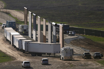 Prototypes for President Donald Trump's border wall with Mexico are shown blocked by trucks before Trump's visit to the area, in this picture taken from the Mexican side of the border, in Tijuana