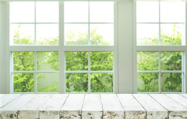 Top of wood table counter on blur window view garden background
