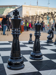 Large, life-sized king and queen chess pieces