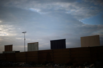 Portions of prototypes for U.S. President Donald Trump's border wall with Mexico are seen behind the current border fence in this picture taken from the Mexican side of the border, in Tijuana