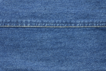 Close up blue jean texture background with seam thread layer