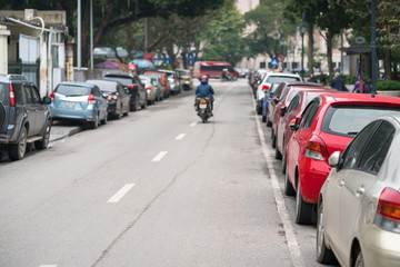 Cars parked on the urban street side