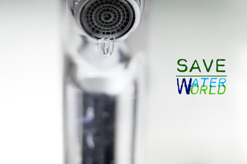 water drop on faucet, world water day concept with copy space