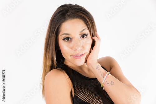 37e5f543b Young fit hispanic woman in black two piece and black high heels posing on  a white
