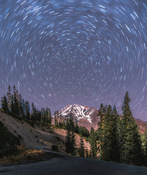 A long exposure captures the star trails around the north star over Mount Shasta