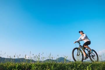Woman ride a bike: summertime activity