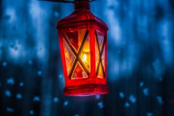 Red lantern is on blue window background