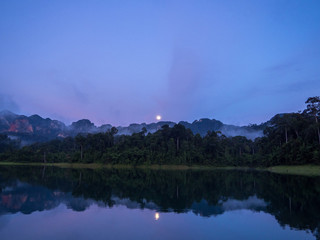 Moon Rise Purple Blue Sky Reflection Over Lake in Thailand