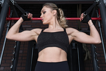 Fitness woman doing exercises for biceps muscle