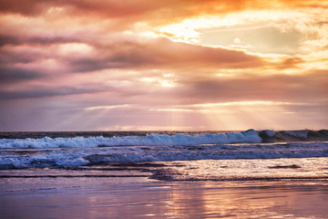 Wall Mural - Sunset on the beach, beautiful pastel tones and rays of sun