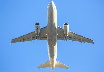 low angle view of a white commercial plane against sky background. fling close up.