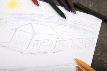 The child draws crayons house