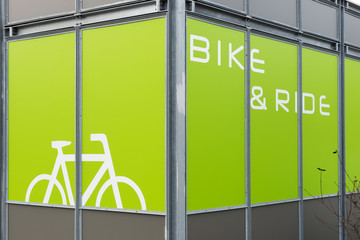 Detail of modern bicycle parking area in green color