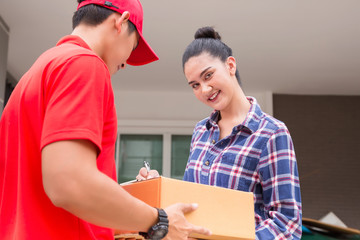 Woman accepting a delivery of boxes from delivery service courier. Isolated on a White Background.