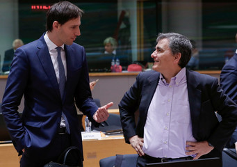 Dutch Finance Minister Hoekstra and Greek Finance Minister Tsakalotos attend the EU finance ministers meeting in Brussels