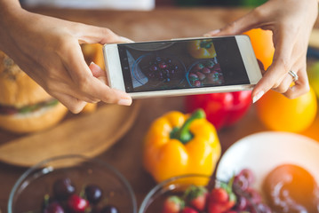 Woman hands taking photo fruit with smartphone, lifestyle concept.