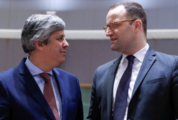 Portugal's Finance Minister Centeno and Germany's designated Health Minister Spahn attend the European Union finance ministers meeting in Brussels