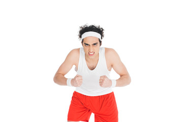 Wall Mural - Portrait of angry thin sportsman isolated on white