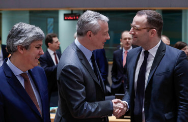 Portugal's Finance Minister Centeno, France's Finance Minister Le Maire and Germany's designated Health Minister Spahn attend the European Union finance ministers meeting in Brussels