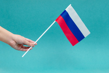 photo of the Russian flag on a blue background