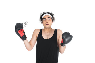 Wall Mural - Shocked thin young boxer taking off eyeglasses isolated on white