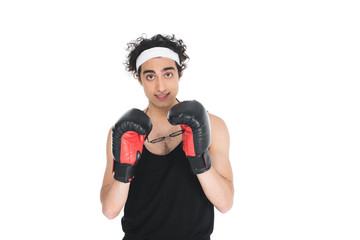 Wall Mural - Young thin boxer putting on eyeglasses isolated on white