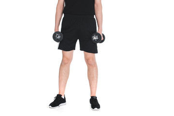 Wall Mural - Cropped image of skinny sportsman with dumbbells in hands isolated on white