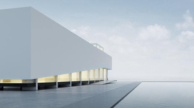 3D rendering of modern architecture with warm interior lighting and minimal pool on mountain background,Concept of design architectural.