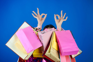 Woman shopping with shopping bag and ok hand sign