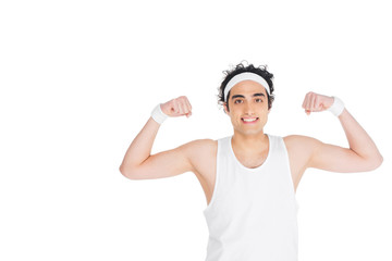 Wall Mural - Young thin man in singlet showing muscles isolated on white
