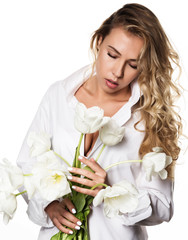 Beautiful curly girl with spring flowers tulips on a white background
