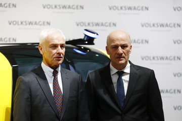 Volkswagen CEO Mueller and CFO Witter pose before the annual earnings news conference of VW in Berlin in Berlin