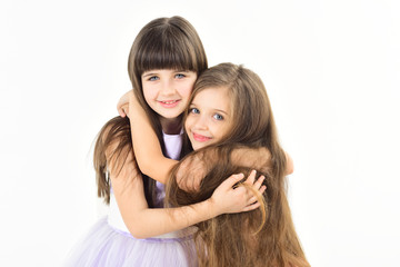 Two funny little girls with long hair.